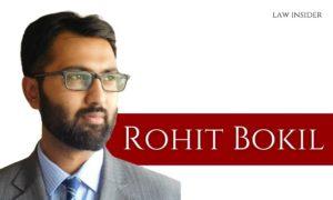 Rohit Bokil picture grey blazer specs